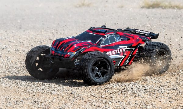 Traxxas Rustler 4x4 Red radio controlled truck on dirt track