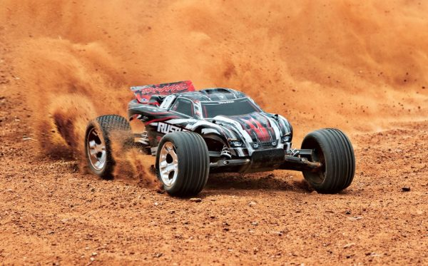 Traxxas Rustler red 2wd radio controlled truck on dirt track